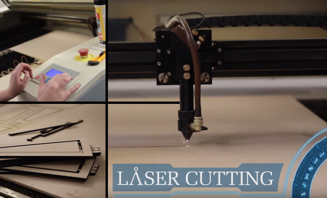 A nice-size industrial laser cutter cutting out some of the 2D shapes.